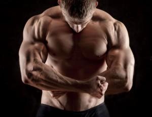 Man flexing post workout.