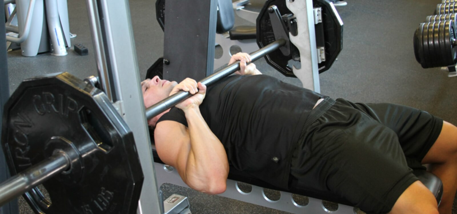 Research Review: Should You Bench Press with a Smith Machine or a Barbell?