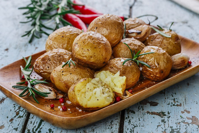 baked potatoes rosemary plate
