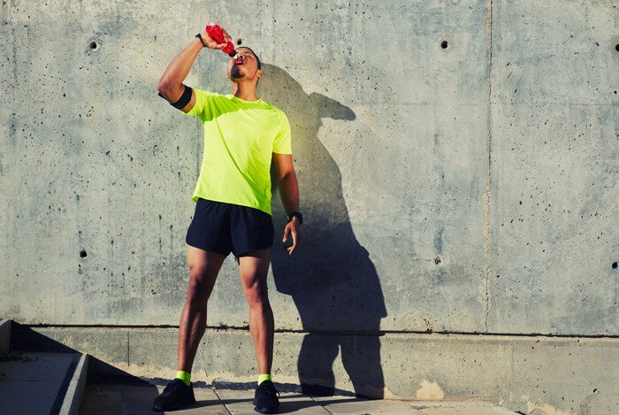 guy drinking sports drink