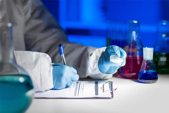 lab scientist bottles notes