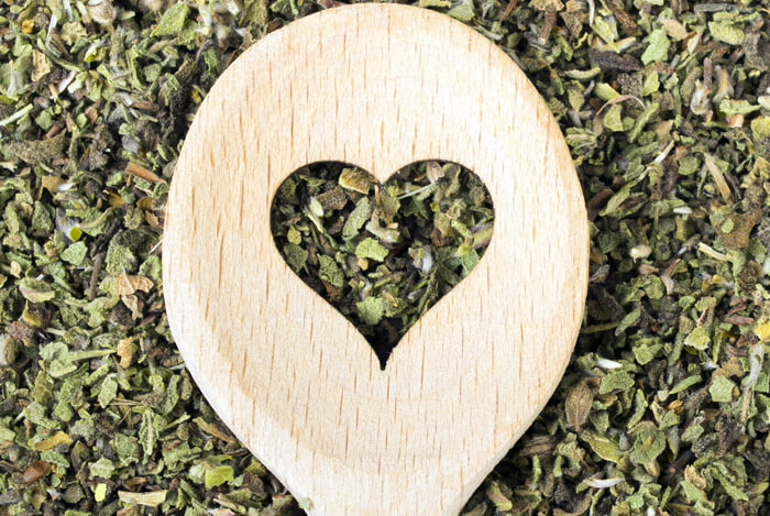 green tea leaves heart spoon