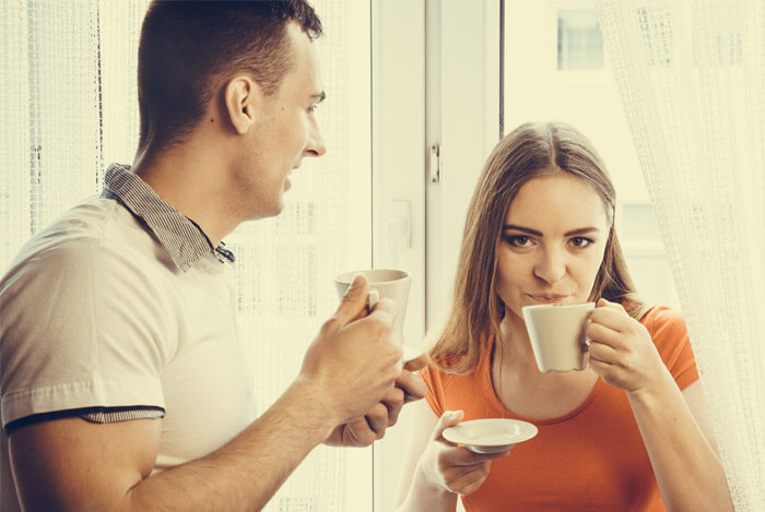 man and woman enjoying tea