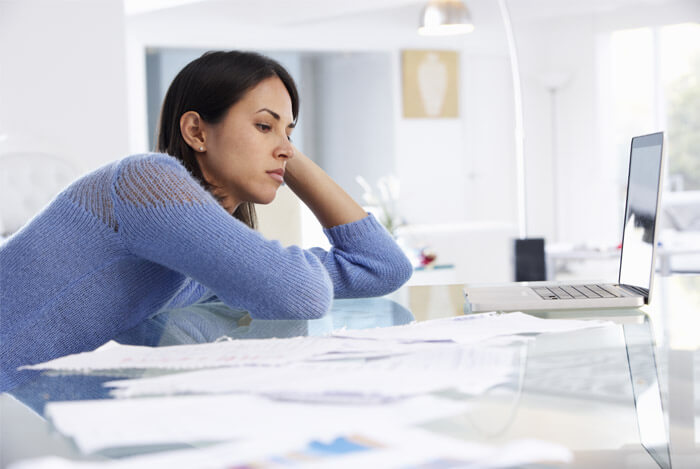 woman stressed bills
