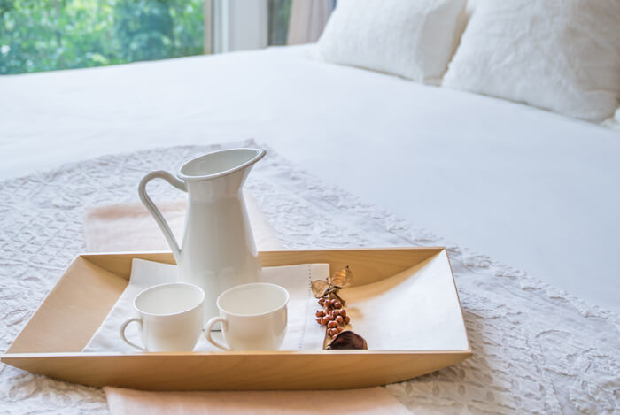 tea tray on bed