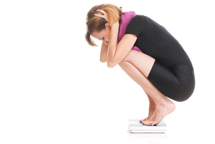 woman on scales weight gain