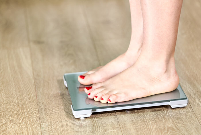 woman on weight scales