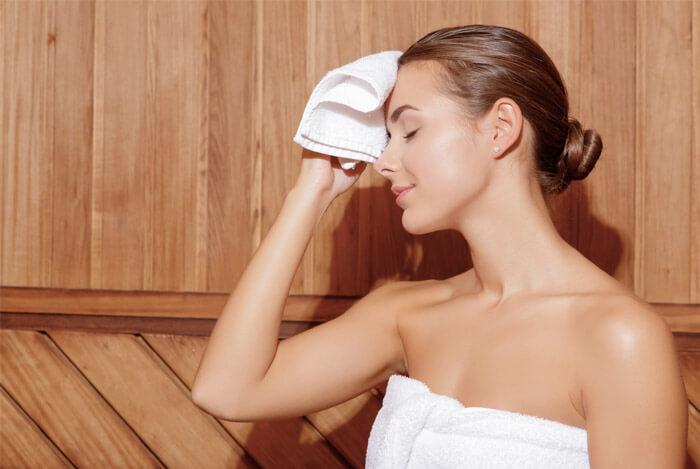 woman sweating suana