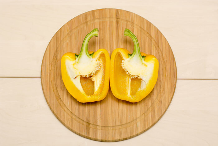 yellow peppers cut board
