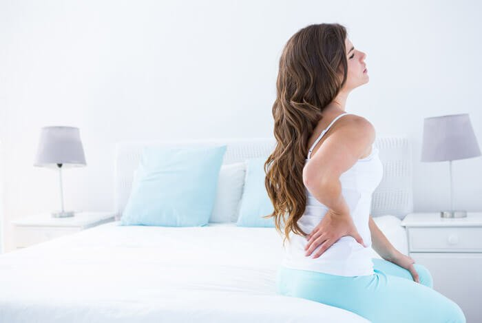 spinal pain woman bed