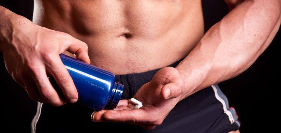 man-taking-workout-supplement